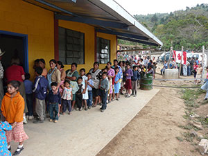 Line-up of people waiting for treatment