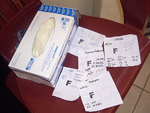 Patient papers by a package of medical gloves